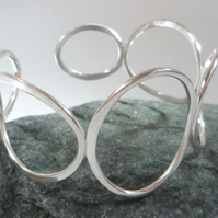 Sterling silver cuff bangle bracelet of large silver rings