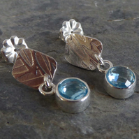 Sky Blue Topaz and silver post and scroll stud earrings
