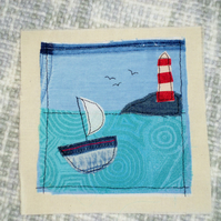Sailing ship and lighthouse hand stitched wall art