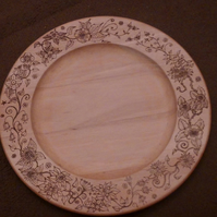 wooden platter hand pyrographed with flower border