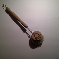 Hand pyrographed novelty scrubbing brush.