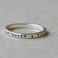 Ring, sterling silver writing, Curiouser & Curiouser.