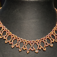 Elegant Gold and Bronze Netlike Beadwoven Necklace.