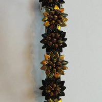 Handbeaded Barrette, Hair Slide with gorgeous Black and Gold Flowers.