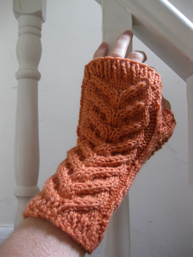 Cabled fingerless mittens in a peach orange cashmere merino blend