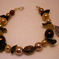 Handmade Brown Bronze Goddess Spiritual Glass Beaded Bracelet with leaf-feather