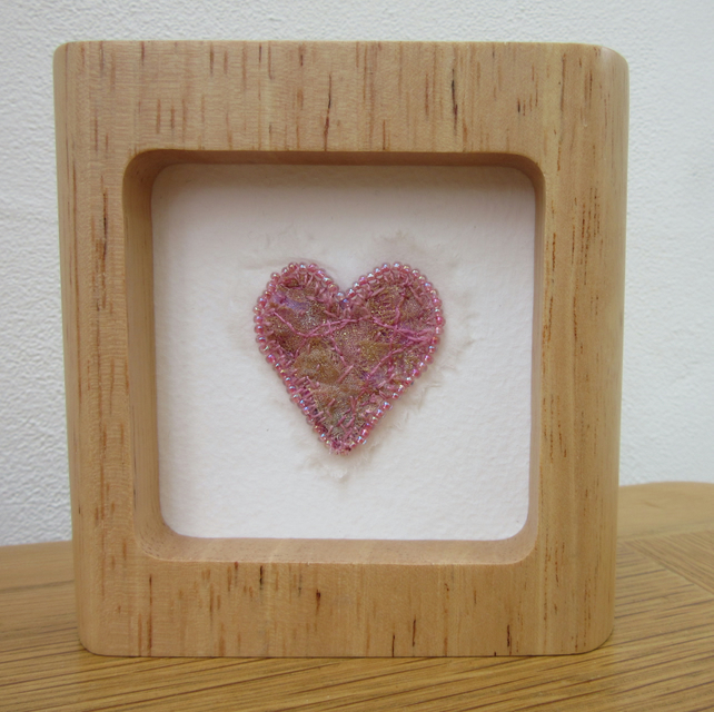 PINK HEART PICTURE. Fabric and thread heart with beaded edge