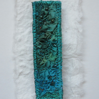 SILK TEXTILE BROOCH with dark jade and turquoise silk machine embroidered fabric