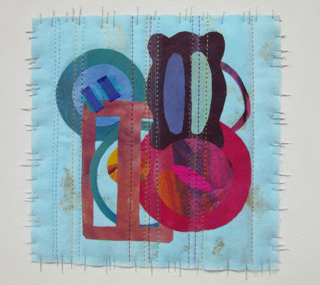 FABRIC COLLAGE PICTURE. Buckles and buttons art textile on canvas