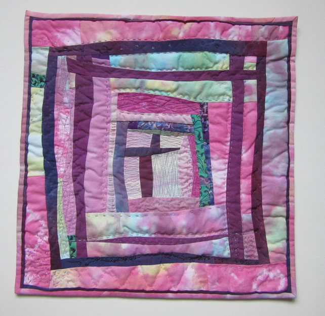 ART QUILT WALL HANGING.  ABSTRACT FABRIC PICTURE IN PINK AND MAUVE