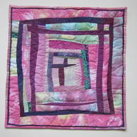 ART QUILT WALL HANGING.  FABRIC PICTURE IN PINK AND MAUVE