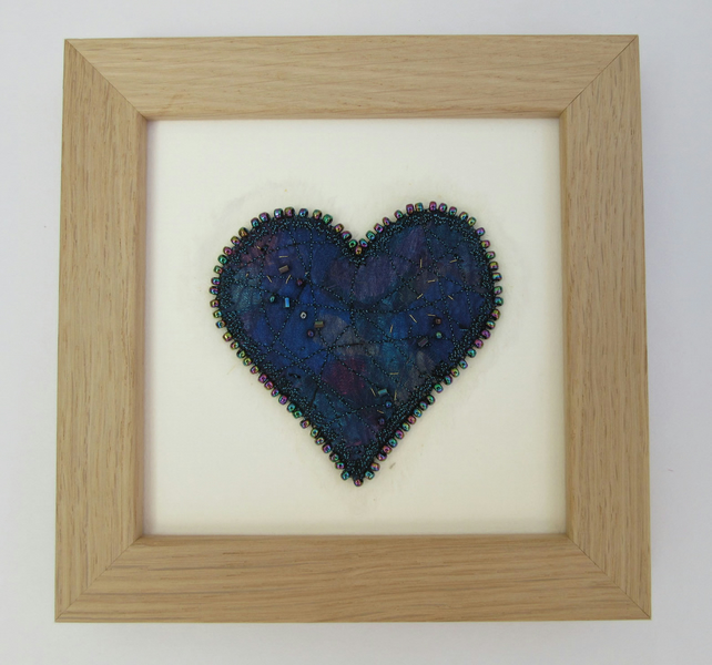 Blue love heart picture.  Turquoise and blue fabric heart with beaded edge
