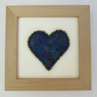 Blue heart picture.  Turquoise and blue fabric heart with beaded edge
