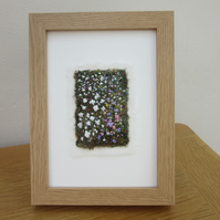 EMBROIDERED GARDEN PICTURE. FRAMED IMPRESSION OF A COTTAGE GARDEN