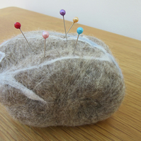 FELT PIN CUSHION.  Hand felted pebble pin cushion made using merino wool