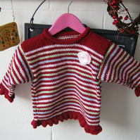 SALE!  Knitted little girls jumper in candy stripe with flower motif