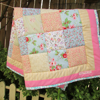 Quilt with pink pastel colours