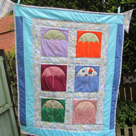 Quilt with umbrella applique, pushchair blanket,cot blanket. Free postage