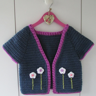 Girls short sleeve crochet cardigan with lovely flower detail. Age 6-8 years