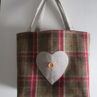 Tweed tote bag with large heart appliqued and button design.