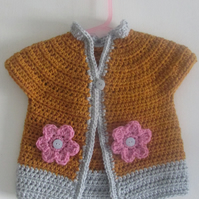 Baby crochet cardigan with flower deail.  Fits age 0-9 months