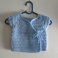 Crochet baby cross over cardigan.  Fits 0-3 months. Free postage to UK Mainland