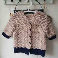 Crochet girls coat with toggle buttons.  Fits age 7 to 8 years old