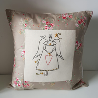 Decorative cushion with hand embroidered primitive angel. Baby gift, baby room