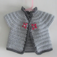 Crochet little girls grey cardigan with flower detail.Age 0-9 months.Free mail