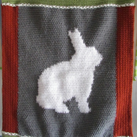 Crochet bunny feature baby blanket, backed with fabric for comfort.Reduced price