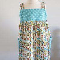 Girls strappy summer dress with side pockets. Age 4 - 5 yrs