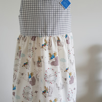 Girls summerdress with bunny garden theme. Age 4-5 years. FREE POSTAGE