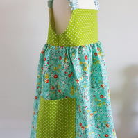 Girls summerdress with elasticated shoulder straps. Age 4 - 5 yrs