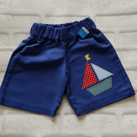 Unisex shorts with sailboat applique. Age 18-24mnth