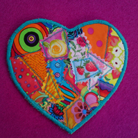 Set of six heart shaped crazy patchwork fabric coasters