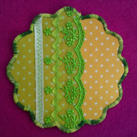 Set of six fabric and vintage lace coasters