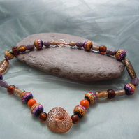 Handpainted Peruvian geometric beads , glass beads & copper spiral bead necklace