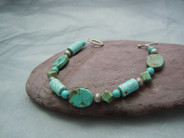 Semi-precious Turquoise bracelet in assorted shape beads & silver plate beads
