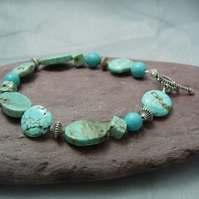 Semi-precious Turquoise bracelet in various shape beads & silver plate beads