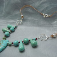 Necklace of assorted shapes of Turquoise beads with glass beads & ribbon