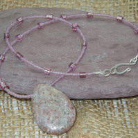 Oval Rhodonite pendant with glass seed beads & silver plate clasp