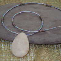 Oval Rhodonite pendant necklace with glass seed beads & silver plate clasp