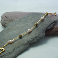 Delicate Freshwater Pearl bracelet with glass beads & a heart clasp