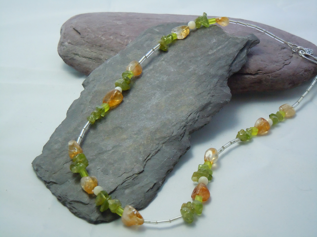 A necklace of Peridot & Citrine semi-precious chips & Mother of Pearl