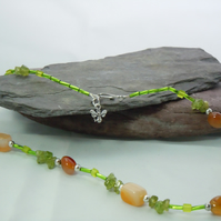 Vibrant Peridot & red Agate necklace with glass & silver plate beads & bee charm