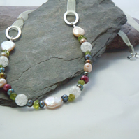 Peridot, freshwater pearls & crackled quartz necklace with a charm & ribbon