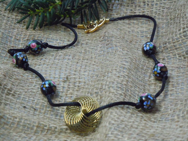 Necklace with handpainted flowers on black glass artisan beads