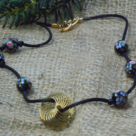 Necklace with handpainted flowers on black glass beads