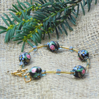 Handpainted flowers on black glass beads bracelet with gold plate heart charm