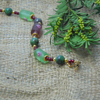 Gemstone Zoisite with Ruby bracelet with glass barrel beads & Tierracast charm